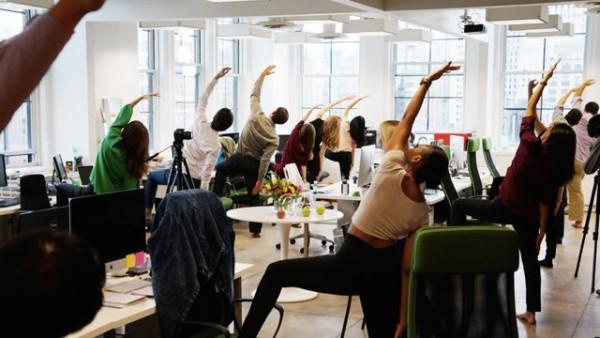 Staff practicing office yoga