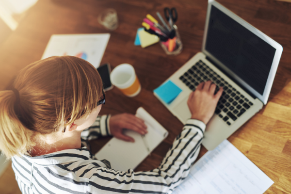 Woman working from home at her desk