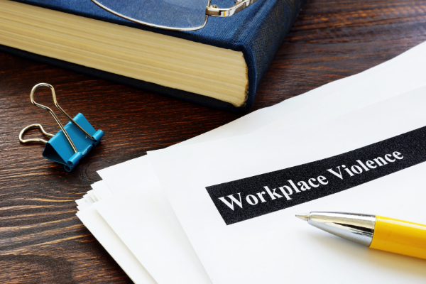 Workplace violence documents on a person's desk