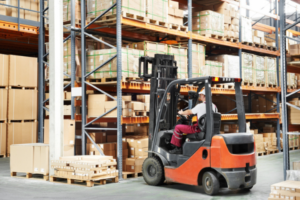 A forklift truck lifting items in a warehouse